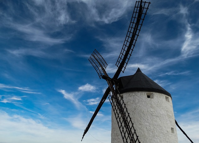 A windmill on a cloudy day
